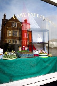 'Cake Expectations' on Botley Road, Oxford: an unexceptional shopfront, but in the window were some of the prettiest cakes I have ever seen, each telling its own Dickensian story. Apologies for the strong reflections in the glass.  March 7, 2015