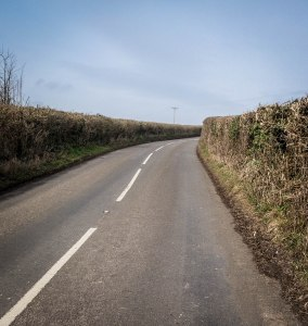 High and dense hedges right up against the road are rather hazardous for a casual walker. March 11, 2015